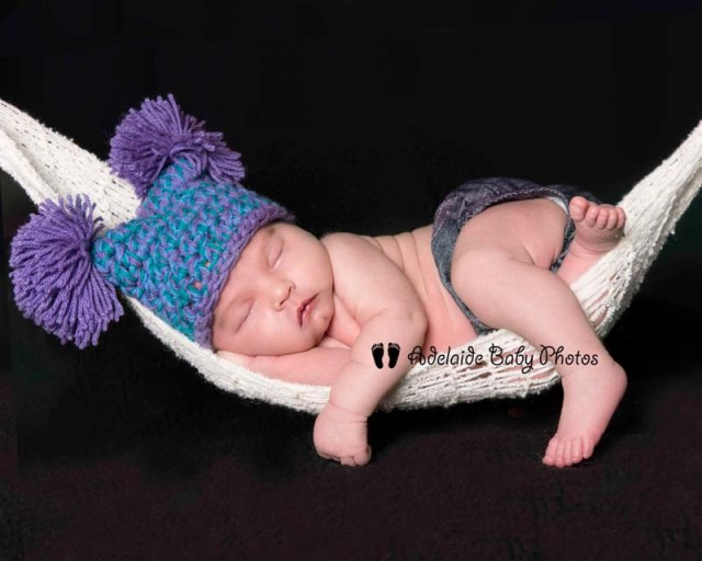Photograph of newborn baby in hammock by Adelaide Baby Photos